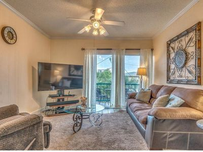 Photo for Beautifully decorated condo JUST STEPS TO BEACH!!