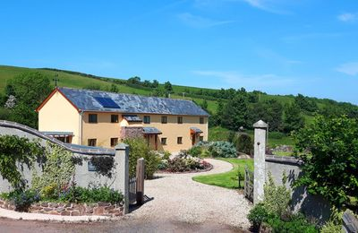 Photo for Middle Hollacombe Farmhouse, a detached property created from ruins of an ancient Devon Longhouse.