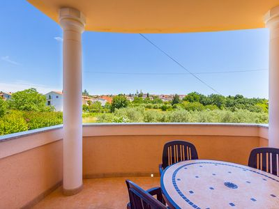 Photo for Great apartment only 800 meters to the sandy beach with kitchen, balcony, barbecue, air conditioning, wireless internet