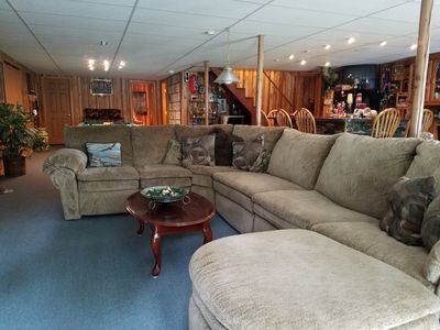 Open common area. Couch is a queen sleeper sofa. Large TV in the room.