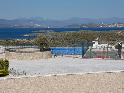 Tennis and basketball courts, running track and view of the Bay of Gulluk