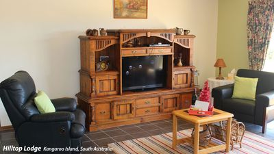 A large TV , board games ,puzzles  and selection of magazines and books.