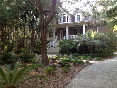 Beautiful palms and live oaks adorn the property