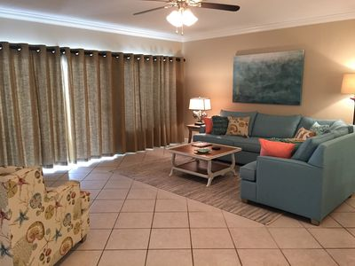 View of Spacious Living Room opening to Gulf Front Balcony