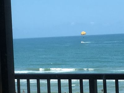 Photo for Oceanfront stunning view from top floor. Perfect vacation just steps from surf!