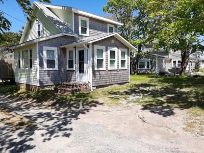 Photo for Sunny Cape cod home walking distance to private beach