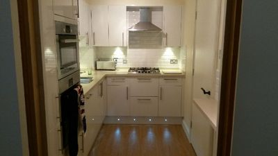Kitchen with appliances including fridge freezer oven microwave & hob