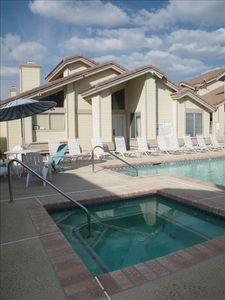 Beautifully maintained swimming pool and hot tub. Swim, relax, soak up the sun.