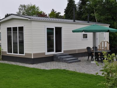 Photo for Comfortable chalets in holiday park in attractive environment and with pool