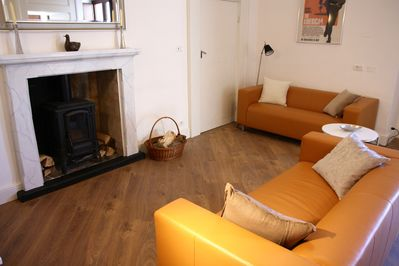 The spacious living room features a wood burning stove.