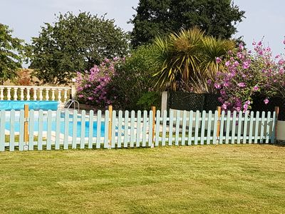 The front garden and heated pool