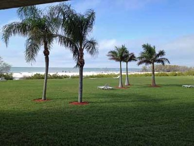 The white sand beach is just steps across our lush lawn.