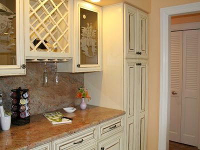 Kitchen leading to hallway - We have provided a Keurig machine so remember to bring your favorite flavors.