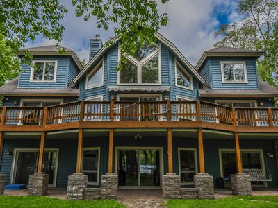 Beautiful home with a level lakefront, 3 master suites & lake views!