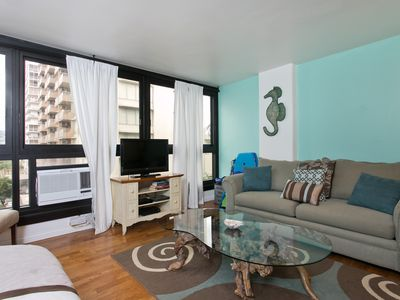 Photo for Oasis in Waikiki with Pool - Steps to the Beach, Zoo, Rooftop Deck, Views!
