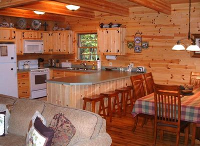 Kitchen & Dining Room leading out to covered porch overlooking creek