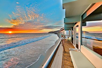 View of the Sunset over the Pacific Ocean from the balcony of this gorgeous unit.