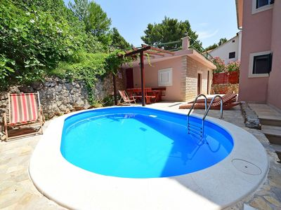 Photo for Lovely apartment for 8 people with WIFI, A/C, private pool, TV, balcony and parking