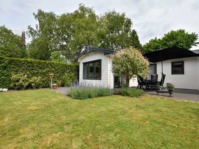 Photo for Spacious chalet with beautifully maintained garden in quiet holiday park adjacent to woods
