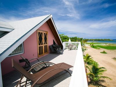 Photo for Beach front home, 4 Bed/4 Bath/King Bed Loft for diving, snorkeling and relaxing