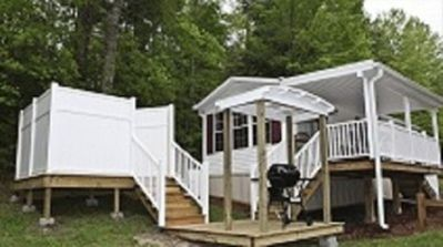 Cardinal Cottage with covered deck, grill area and private hot tub.