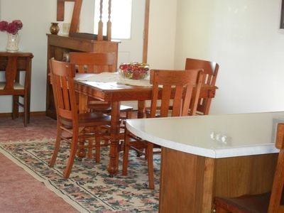 A portion of the kitchen counter is dining height for additional dining seating.