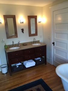 Double sink in the master bath and a hint of the original clawfoot tub
