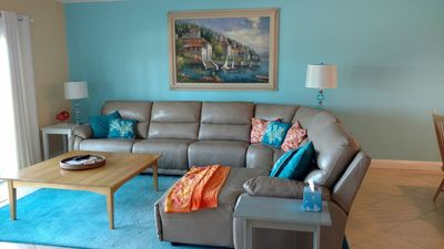 Living room overlooking water, with large, comfy sectional