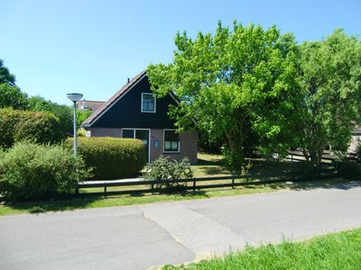 Photo for Holiday house with winter garden in a quiet holiday park with swimming pool - North Holland
