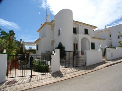 Photo for Modern luxury villa in secluded gardens, close walk to the beach, marina & town