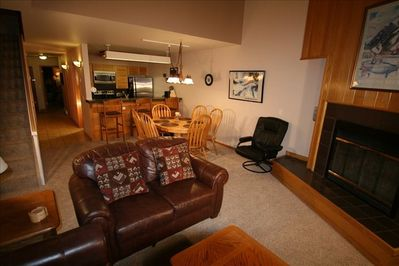Family room to kitchen including gas fireplace