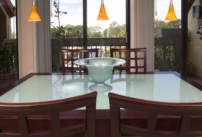 Rich Contemporary Mahogany & Seaglass dining table for 6 overlooking the harbour