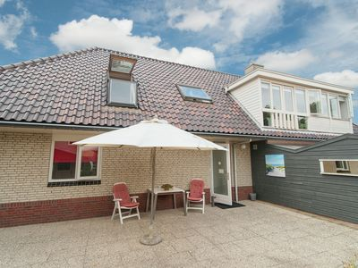 Photo for Apartment with sauna on the beach at Bergen aan Zee with private parking space