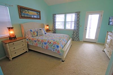 Master bedroom with private balcony. Flat screen TV, Smart DVD player.