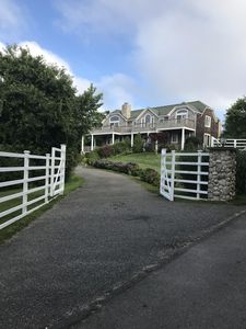 Front of house, with fencing surrounding the property.