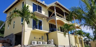 Photo for Spectacular Sunsets and Ocean Views in Brand New 2 Level Villa & Rooftop Terrace
