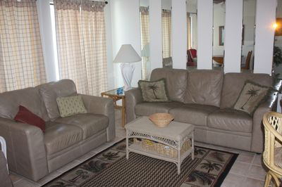 Living room with sofa/sleeper, loveseat, flat screen TV, rocking chair