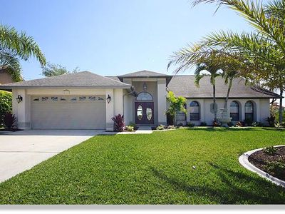 Photo for 'Villa Sunrise' holiday house with pool and boat dock in Cape Coral, Florida