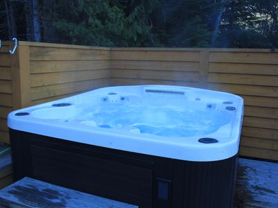 Photo for Beautiful 4 bedroom Whistler chalet, private hot tub, walk to lifts in minutes