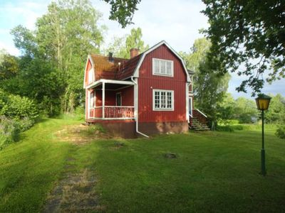 Photo for Cottage by the lake with private dock, boat, sauna and large garden with barbecue area