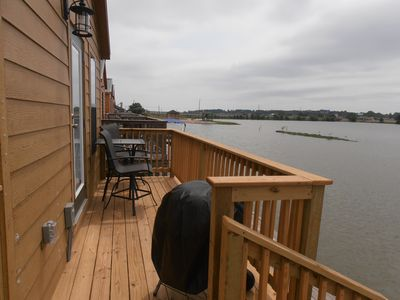 Deck facing Lake with table + 2 chairs and coal Bar-B-Q