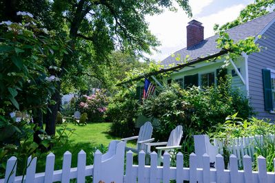 Front yard with lawn chairs and lush garden