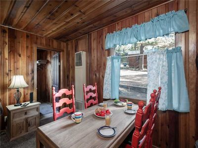 Welcome to Pine Cabin - Experience the mountain magic of Ruidoso at a charming log cabin style vacation home for up to six guests.