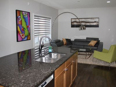 Photo for Executive Aspen Woods Home - 15min to COP, DT & Stampede Ground, 55min to Banff