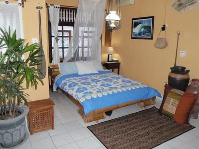 Upstairs Bedroom with Air con,ceiling fan,T.V. DVD & Private Balcony.