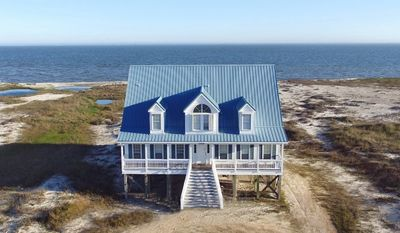 Photo for Relaxation- Large, Bayfront Home yet just across the street from the Gulf Beach, too!