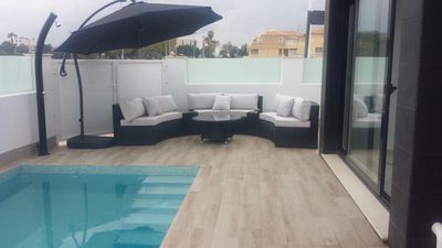 Photo for Modern detached south facing 3 bedroom villa with pool and solarium