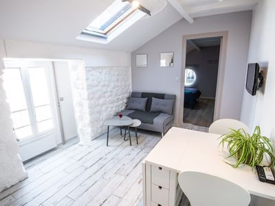 Photo for Atypical 2P stones and exposed beams calm renovated 15 min from the Champs Elysees