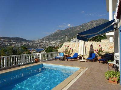 Private pool with sun shades and view into Kalkan Town