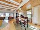 Dining Area - This idyllic coastal retreat boasts an open flow and natural wood throughout.